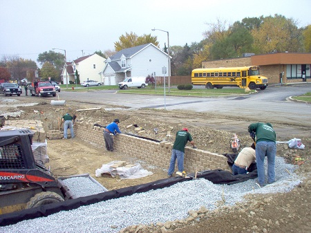 commcerial retention pond retaining wall install 1